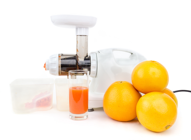 Making Ruby Red Grapefruit Juice with a Juicing Machine