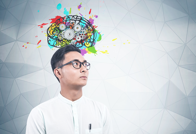 A middle age man thinking with a brain and gear illustration above his head