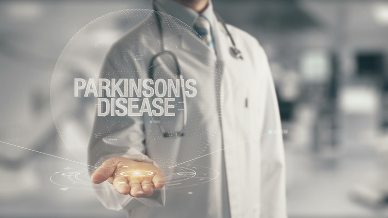 a doctor holding out his hand to parkinson's disease